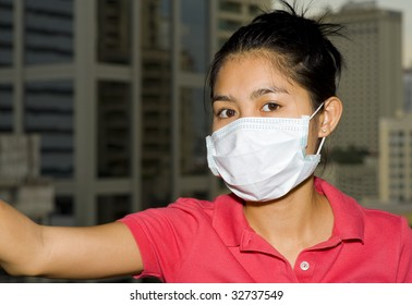asian woman with face mask in front of the bangkok skyline