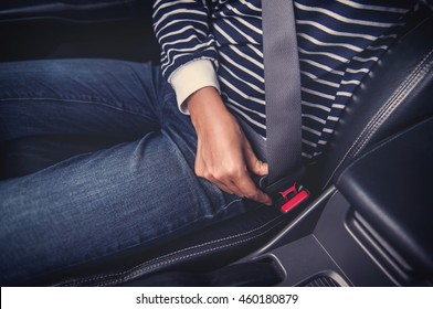 Asian woman fastening seat belt in the car,Focus on strap