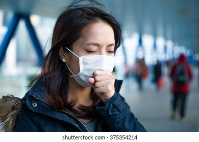 Asian Woman feeling unwell at outdoor