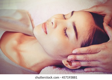 Asian woman getting thai herbal compress massage in spa  , Vintage Style