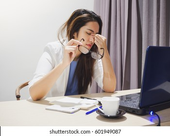 Asian woman got headache from working on notebook all day long