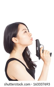 Asian woman with gun isolated on a white background