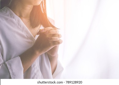 Asian woman hand praying peacefully in the morning