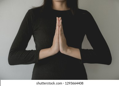 Asian woman with hand in praying position,Female pay respect or put your hands together in a prayer position