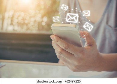 Asian woman hand using mobile phone with e-mail application, Concept email newsletter and antivirus spam mail protection