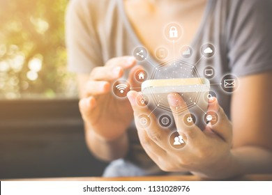 Asian woman hand using smartphone with icon technology communication and internet of things (IOT). Innovative convenience smart life concept
