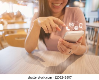 Asian woman hand using smartphone with icon telephone email mobile phone and address. Contact us connection concept