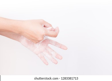 Asian woman hand are washing with soap bubbles on white background, Health and Lifestyle Concepts, Global Handwashing Day, hygienic practice