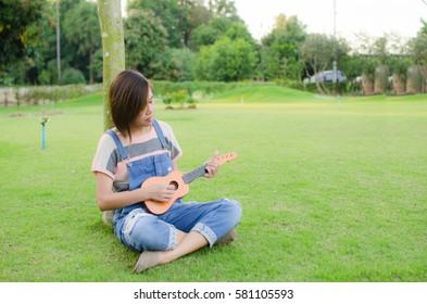 Asian Woman Happy Play Ukulele