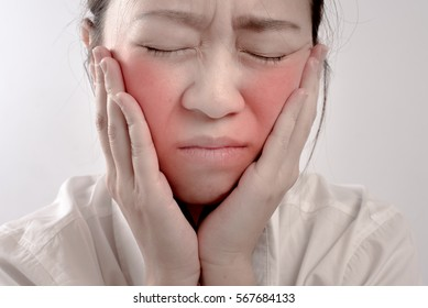 An Asian woman has a pain in toothache isolated on white background