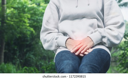 Asian woman have a bladder pain or uti pain after wake up in the morning feeling so illness,Healthcare Concept.color tone