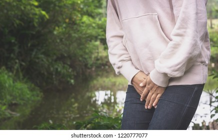 Asian woman have a bladder pain or uti pain after wake up in the morning feeling so illness,Healthcare Concept.