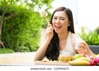 Asian woman have diet breakfast with yogurt and fruit for health in morning