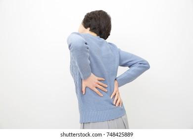 Asian woman having a backache