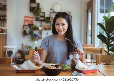 Asian woman was having breakfast in restaurants