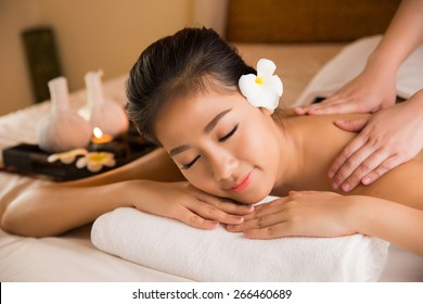 Asian woman having massage and spa salon Beauty treatment concept. She is very happy