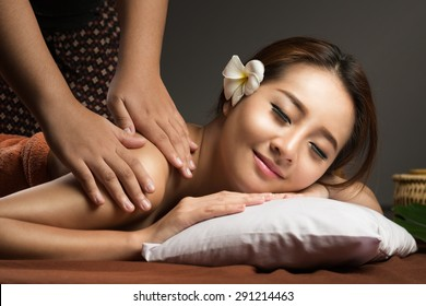 Asian woman having massage and spa salon Beauty treatment concept. She is very relaxed
