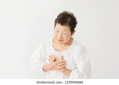 Asian woman having a palpitation of the heart