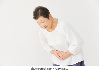 Asian woman having a stomachache