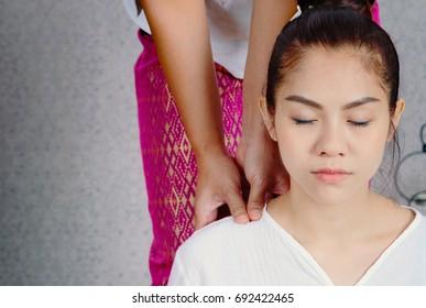 Asian woman having Thai deep massage in spa salon ,Beauty spa concept