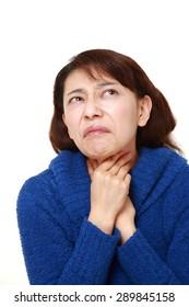asian woman having throat pain