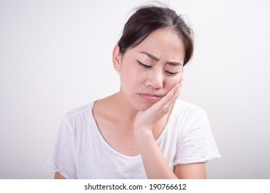 Asian woman having toothache
