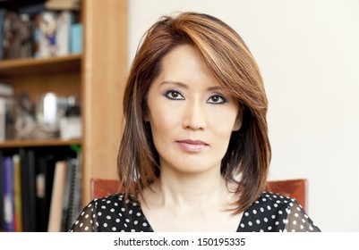 Asian woman in her office