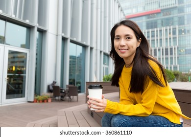 Asian woman hold with coffee