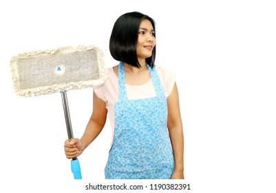 Asian woman hold mop for cleaning and smile isolated background