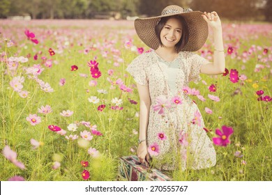 Asian woman holding a bag with the flag of England. Flowers to collect tax She relaxed a trip to the garden,vintage color