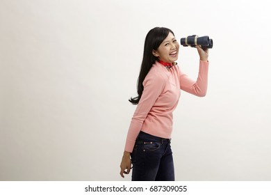asian woman holding a binoculars on the white background