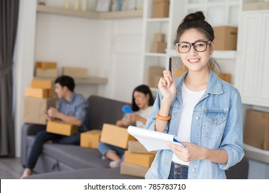 Asian woman holding box with attractive smiling . People with SME, Delivery, Online Business concept.