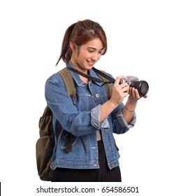 Asian woman holding a camera isolated on white background
