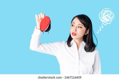 Asian woman holding a coin purse.