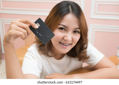 Asian woman holding credit card using as background business concept
