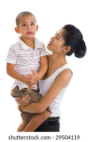 asian woman holding a cute crying boy
