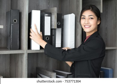Asian woman holding document at working place, woman working concept.