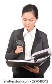 Asian woman holding file with magnifying glass