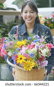 Asian woman holding flowers in basket