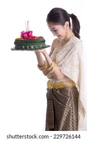 Asian woman holding Khratong for wish and respect god of river on Roikhratong Day with white background