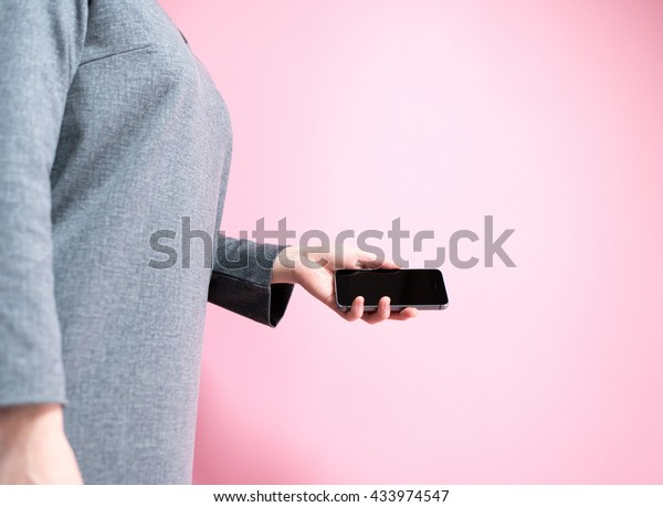 Asian woman holding a smart phone