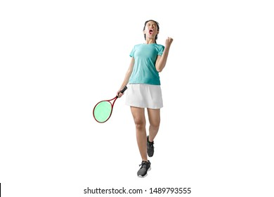 Asian woman holding a tennis racket with a happy expression isolated over white background