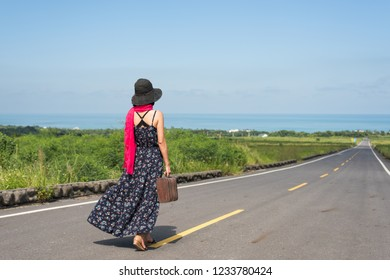 Asian woman holding a vintage and walk at the outdoor, concept of travel