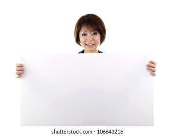 asian woman holding a white board