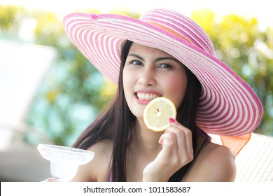 Asian woman holding wine glass at pool. People lifestyle concept.