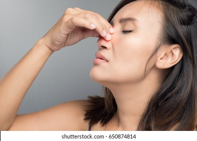 The asian woman hurts her nose because she has cold.