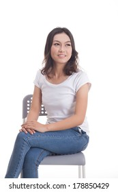 Asian woman isolated on white background. white t-shirt, sit on chair