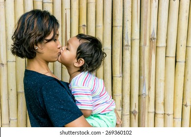 Asian Woman Kissing Her Son. South-East Asian Woman With Her Mixed-Race Baby.