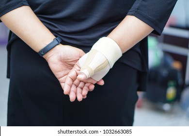 Asian woman lady with wrist hand pain support : office syndrome concept