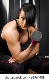 Asian woman lifting weights in gym